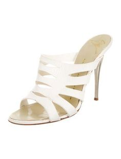 White leather Giuseppe Zanotti round-toe slide sandals with tonal stitching and silver-tone metal heels.