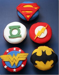 Justice League cupcakes-i know what symbol goes to what super hero! thank you lucas! and the big bang theory :)
