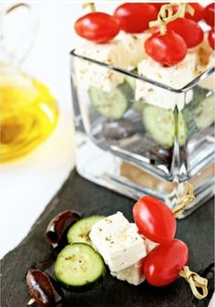 Skewers of tomato, cheese, cucumber and olive