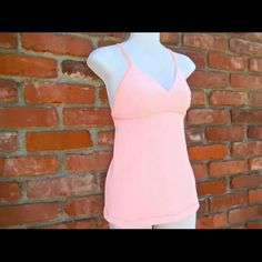 Lululemon Tops - Lululemon Athletic Fitness & Yoga Running Tank. XS-Small. Preowned in wonderful condition. $18. Cute criss cross backside!
