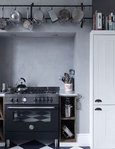 This kitchen was was commissioned by Oscar winning costume designer Jacqueline Duran for her house in North London. She asked interior designer Mark Lewis for a space that was layered with aged textures but also contained very modern functionality. The Bertazzoni range was at the centre of the design that combined reclaimed wood paneling, grey lime plaster walls and carrara marble surfaces. Photographed by © Rory Gardiner Interior design by Mark Lewis Interior Design