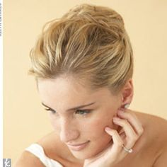 A divine alternative to a basic updo, this carefree-looking Grecian style is curled, twisted, and pinned at random so it's practically effortless to re-create.