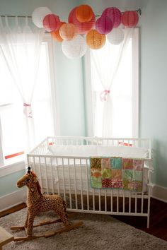 Reuse lanterns from baby shower to decorate..cute! Love the way the way the wondows look so simple but elegant!