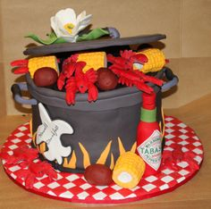 Crawfish Boil - Thanks so much to Scrumptious Creations and the rest of CC cakes for the huge help in coming up with a cool design to try on this cake. This was 4- 9 inch layers with BC.. All done in fondant and gumpaste. Label on Tabasco bottle is edible image. Corn was made out of fondant. I individually rollled little balls to create the look. Crawfish was a mold that I trimmed and molded with my hands. Cake board is fondant covered. I learned really quick that I next time to used ...