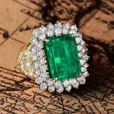 Lot: A 7.48-Carat Colombian Emerald and Diamond Ring, Lot Number: 0067, Starting Bid: $16,000, Auctioneer: Fortuna Auction, Auction: Fine Jewels, Date: February 22nd, 2018 EST