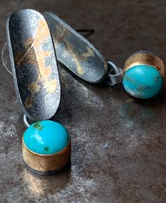 Beautiful pair of Turquoise cabs set in 14K Gold, hanging from a one of a kind patinated Sterling Silver piece with 14K Gold 'veins'. Made for pierced ears. Fine Jewelry, Jewellery, Turquoise Earrings, Gemstone Colors, Jewelry Branding, Luxury Jewelry, Ear Piercings, Colored Diamonds, Ears