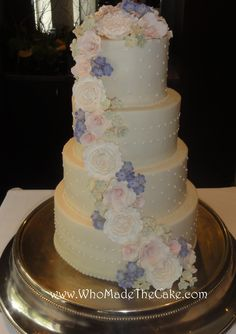 Dainty buttercream wedding cake with sugar paste flowers. #classiceweddingcake #elegantweddingcake #weddingcakes #floralweddingcake #WhoMadeTheCake
