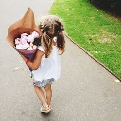 Ivy and I walked up to the village to buy flowers and she insisted on carrying them (almost) all the way home.