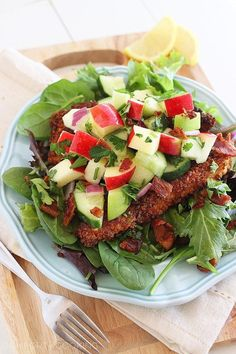 Crispy Chicken Salad with Apples and Bacon Recipe ~ Loaded with fresh, crunchy apples and cucumbers tossed in a simple lemon-honey vinaigrette, this salad's got it all goin' on. A handful of chopped red onion adds a little sass, and crispy crumbled bacon adds a nice salty crunch to the sweet apple salsa