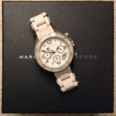 Marc by Marc Jacobs Rock Gunmetal & Cream Watch Unisex watch with round gunmetal ionic plated stainless steel case, cream dial, date window, and 3 chronograph sundials, deployment clasp closure and quartz movement. Water resistant up to 50M. Case measures 40 mm wide. Bracelet measures 20 mm wide. Includes original packaging, additional links and instruction manual. Watch has light wear and one tiny nick on watch face perimeter. Marc by Marc Jacobs Accessories Watches