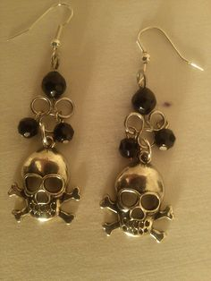 Skull and crossbones earrings with swarovski crystal by tonnibrill, $22.00