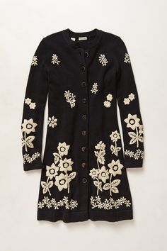 Love the look of this embroidered sweater coat, but given cotton's the first material listed, it's not going to be all that warm.