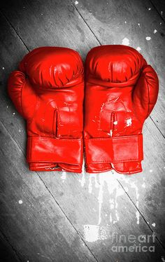 Close-up of vivid red boxing gloves on grey wooden background. Match ring still-life by Jorgo Photography - Wall Art Gallery