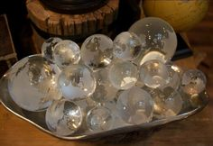 These beautiful miniature glass globes will be an excellent decorative addition to your desk or study.