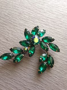 #Vintage Green Rhinestone Brooch. Gorgeous green marquis rhinestones set in gold tone metal with an aurora borealis center stone. Show stopper!   +Condition: Very Good. Pin ... #etsygifts #shopnow #vintage #jewelry #vintagepaige