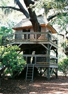 A two-storey tree house with decorative railings.