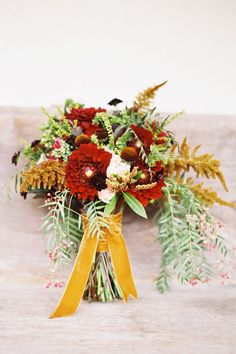 oxblood dahlia and gold bouquet from Bash, Please Fall Bouquets, Fall Wedding Bouquets, Bridesmaid Bouquet, Floral Wedding, Wedding Flowers, Bouquet Wrap, Bridal Bouquets, Marigold Wedding, Gold Bouquet