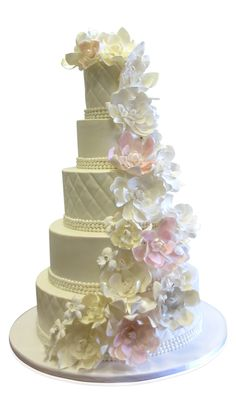 Wedding Cake With Cascading Flowers Every wedding deserves a truly special cake and this creation by our designers was a joy to behold! Elegant, graceful and refined, this 5 tier cake perfectly suited the hugely prestigious affair which was held at the Brooklyn Museum. The cake is made with 5 round tiers all covered in a delicate ivory shaded fondant. The decorations on the ..... http://cmnycakes.com/gallery2/v/Cakes+For+All+Occasions/Wedding+Cake+With+Cascading+Flowers.html?