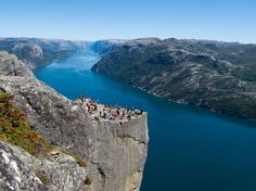 Preikestolen / Preacher's Pulpit, Norway.  The cliff was formed during the Ice age, about approx. 10,000 years ago, when the edges of the glacier reached the cliff. The water from the glacier froze in the crevices of the mountain and eventually broke off large, angular blocks, which were later carried away with the glacier. Along the plateau itself there continues to be a deep crack. Geologists of the region, however, confirm the safety of the plateau.