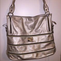 Prada purse Silver Prada purse with black/gold/silver zippers. Never been carried! Very spacious. Prada Bags Shoulder Bags