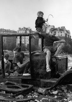 +~+~ Vintage Photograph ~+~+   Children letting their imagination run wild.  Photograph by Robert Doisneau.