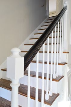 Polyurethane stain in one- espresso finish and white paint. A time consuming makeover for the stairs, but totally worth it.