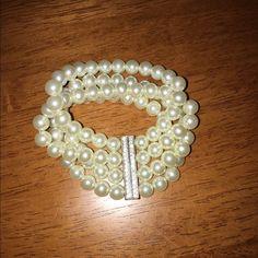 Imitation Pearl Bracelet with Rhinestone Bar Fake pearl bracelet with double sided rhinestone bar. It is a stretch bracelet. Reasonable offers welcome. Jewelry Bracelets