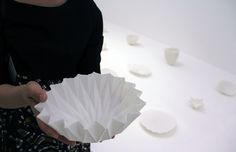 Hitomi Igarashi says these porcelain forms are much thinner than normal ones due to her process of casting them within folded paper shapes.