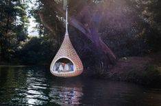 the NESTREST is a new hanging pod woven from supersized strands of 4-cm-wide Dedon fiber. I want one for my backyard. Or two. Or three.