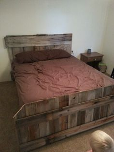 Old barn door headboard. With matching footboard from old fence boards.