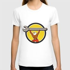 American Bald Eagle Mechanic Spanner Circle Cartoon T-shirt Illustration of a american bald eagle mechanic lifting giant spanner looking up to the side set inside circle on isolated background done in cartoon style. #cartoonillustration #AmericanBaldEagleMechanic