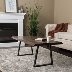 You'll love the simple, straightforward design of this modern coffee table. Capped with a grey distressed wooden top, this table's unique style is complete with the clean lines of the black legs.
