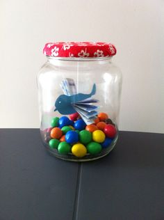 Money present with sweets in a jar