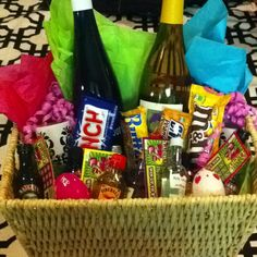Adult Easter basket, bringing to the Easter party so the adults can have a take away, and some fun too! Wine, small liquids, lotto scratch tickets, candles and large candy bars.