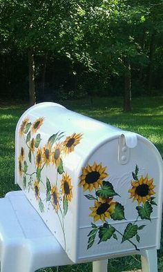 Pretty cheerful sunflowers adorn this standard size mailbox. your one of a kind mailbox is finished several times with clear enamel sealer to