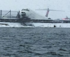 The nose of the Delta MD80  was hanging over Flushing Bay after slidding off the runway at  LaGuardia Airport, New York  5 March 2015