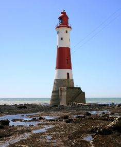 The Eastbourne lighthouse rests at the foot of Beachy Head