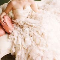 """""""i just want to be swallowed up by ruffles!""""  This dress has a gorgeous watefall train and a touch of vintage bling at the waist.  pretty pink and gold wedding inspiration   http://www.weddingchicks.com/gallery/gold-and-pink-wedding-ideas/?nggpage=6"""