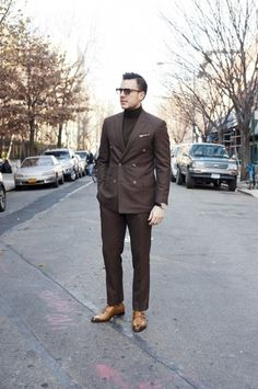 When it comes to timeless refined style, this pairing of a dark brown double breasted blazer and dark brown dress pants never disappoints. Complete this ensemble with a pair of tan double monks to add an element of stylish nonchalance to this outfit. How To Wear Turtleneck, Turtleneck Suit, Mens Fashion Suits, Mens Suits, Men's Fashion, Suit Men, Fashion Lookbook, Business Casual Men, Men Casual