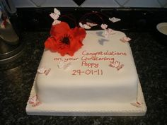 Poppy and butterfly cake