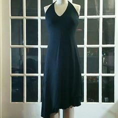 White House Black Market Tie Neck Halter It has a double layered asymmetrical hem for a fluff effect.  It's a very simple yet class black dress. It has NEVER BEEN worn, practically brand new White House Black Market Dresses Midi