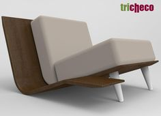 TRICHECO -  Tricheco is a low armchair consisted of a folded panel of cherry and by two pillows. The structure is larger than cushions obtaining in the same structure, as well as an armchair a supporting area appropriate for both a coffee table or a magazine rack.