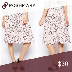 ASOS Heart Print Midi Skirt Waist measured across top band 11.5inches unstretched but is elastic band so there is stretch, length is approx. 23 inches • 92% viscose, 8% elastane • Wash with similar colors • Pockets on both sides ASOS Skirts