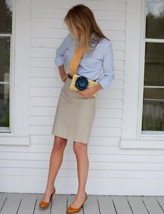 Grey skirt, blue blouse and orange tie