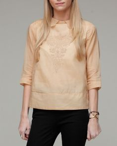 I love pink-hued tan colors and the boxy fit is offset by the femininity of the eyelets.