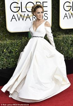 The stars of Hollywood made no concession to the stormy weather, as they strutted their stuff in a dazzling array of couture gowns at the 74th Golden Globes on Sunday.