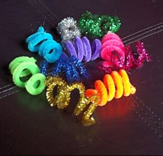 Cheap toy for cats who love to play....coiled pipe cleaners