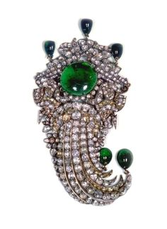 Pics of Iranian Crown Jewels, now in possession of the Museum of Iranian Crown Jewels Truly breathtaking and lavish pieces of jewelry commissioned by the Shah of Iran Brooch laid with emeralds, white and yellow diamonds