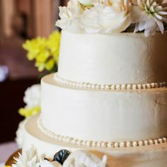 Simple Ivory Buttercream Cake with pearl accent and floral topper