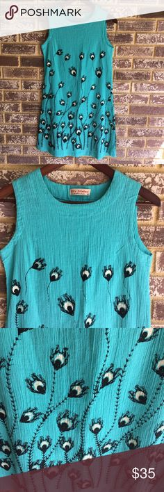 Beautiful peacock print dress Like new, gorgeous turquoise peacock print dress. There's no tag labeling the material but it feels like a silk/cotton blend, just based on a comparison to another item I have like it. This dress is gorgeous and perfect for warm weather! Dresses